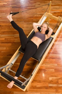 Woman Using Pilates Reformer